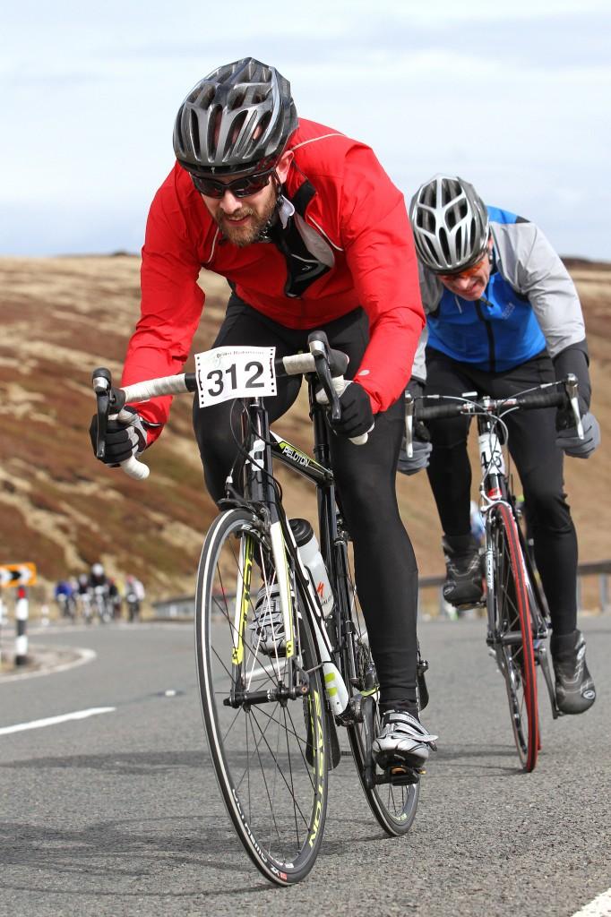 Note the seasoned roadie sheltering behind the clueless newbie rider.